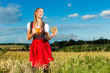 young woman wearing dirndl and has