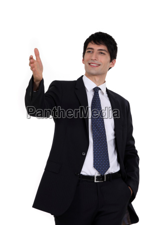 happy businessman directing with hand