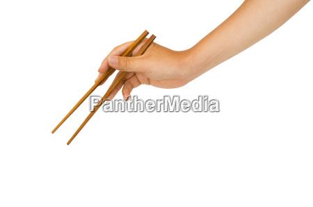 mano che tiene bacchette