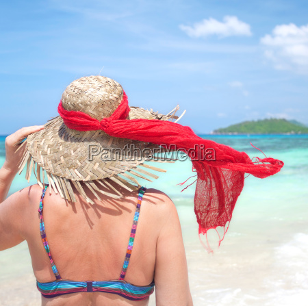 woman with sunhat on the beach