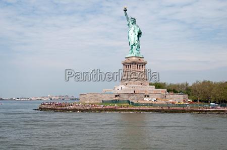 statua estate piedistallo torcia statua della