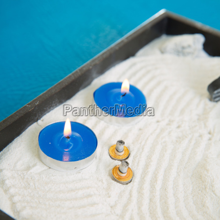 zen little garden with blue candles