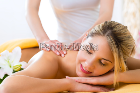wellness woman receiving back massage