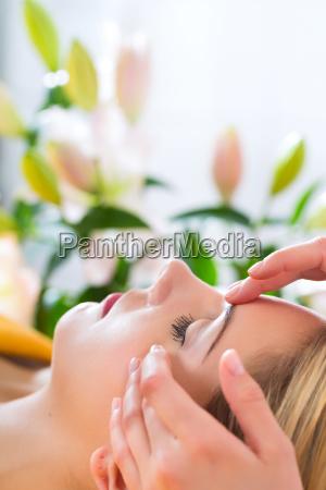wellness woman gets back massage