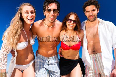 friends on beach vacation in summer