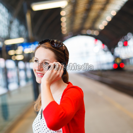 pretty, young, woman, at, a, train - 10198801