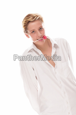 young woman holding lollipop transversely in