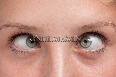 close up squinting eyes of a