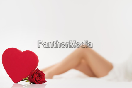 red heart with rose in front