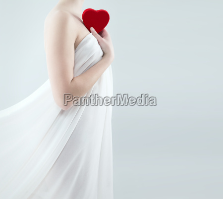 young woman with heart on the