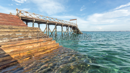 wooden bridge into the indian ocean