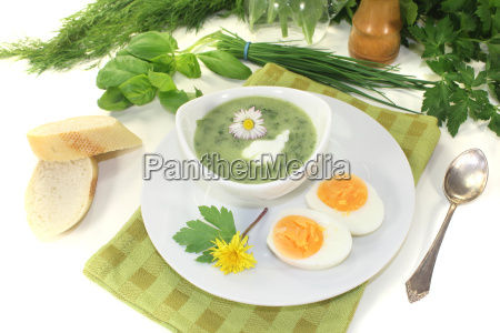 herb soup with a dollop of
