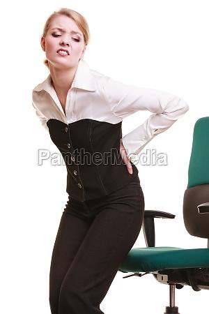 imprenditrice con il mal di schiena