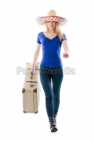 ragazza bionda con la valigia