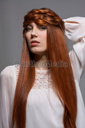 young attractive woman with long red