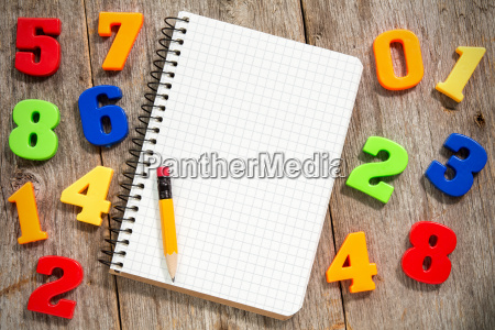 colorful numbers and empty notebook