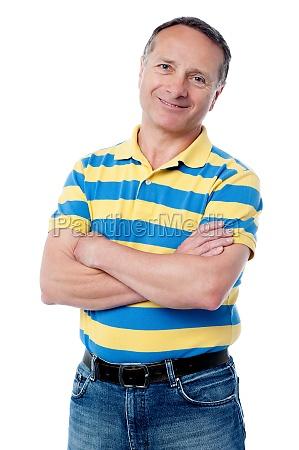 senior man posing with arms folded