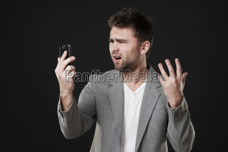 frustrated man with mobile phone