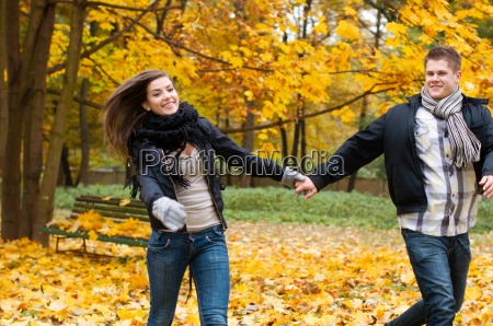 beautiful young couple running in the