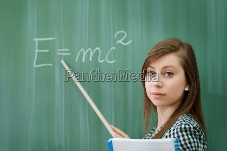 student girl showing emc2 formula