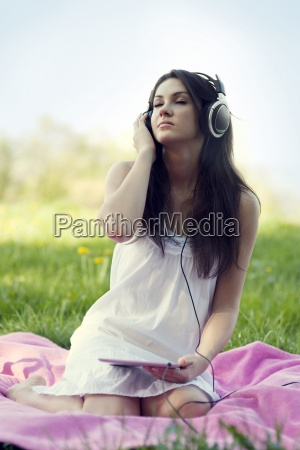 young woman listening to music on