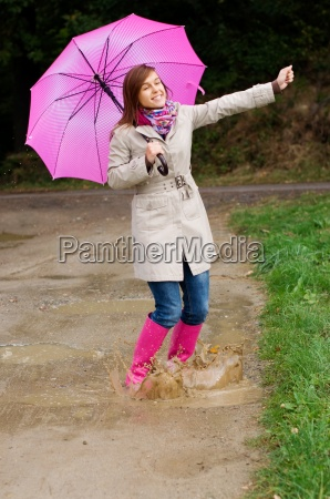 young woman with rubber boots have