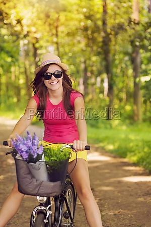 beautiful woman have fun during cycling