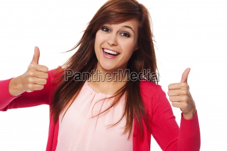 young happy woman showing thumbs up