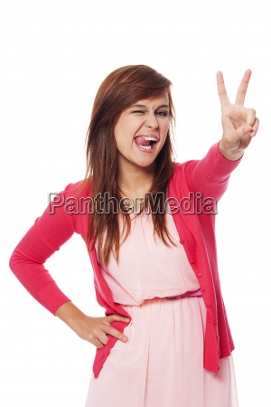 funny young woman showing victory sign