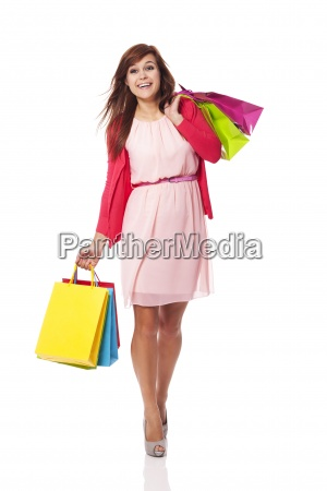 attractive woman walking with shopping bags