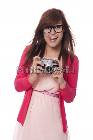 mischievous young woman with vintage camera