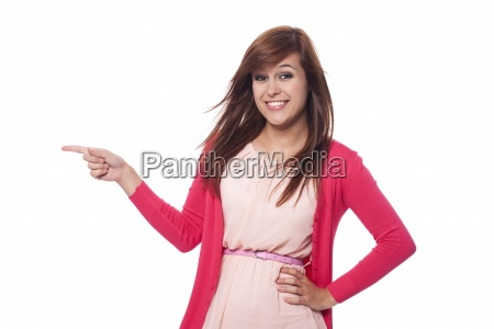 beautiful woman in pink clothes pointing