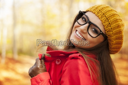 fashionable young woman enjoying in autumn