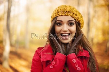 portrait of shocked woman in autumn