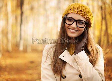 portrait of beautiful woman at autumn