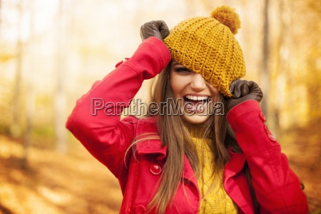 young woman have fun with autumn