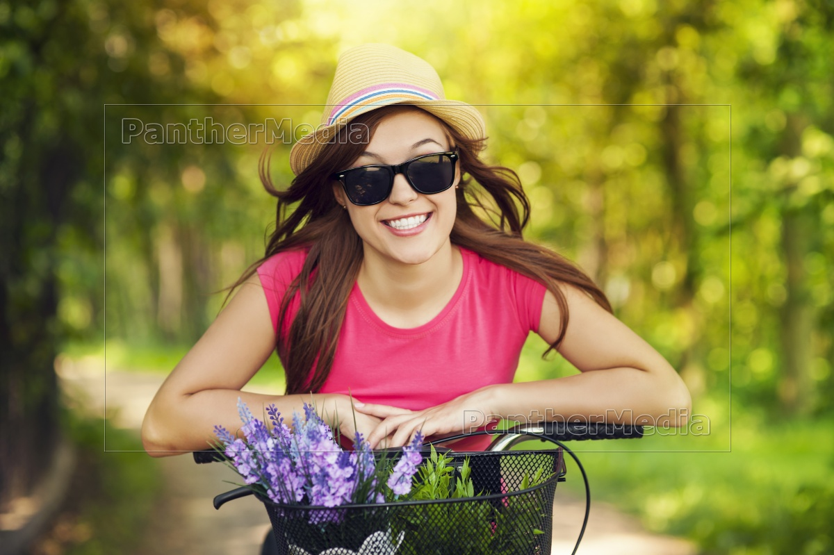 portrait, of, smiling, woman, riding, bicycle - 12109556