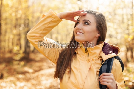 young smiling female hiker looking far