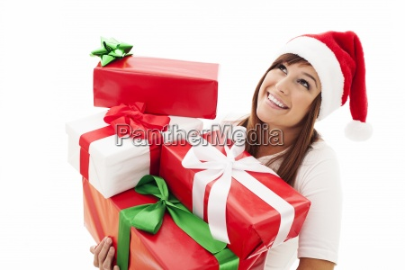 happy woman with stack christmas gifts
