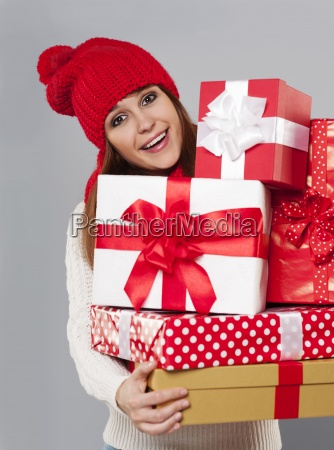 beautiful young woman with stack of
