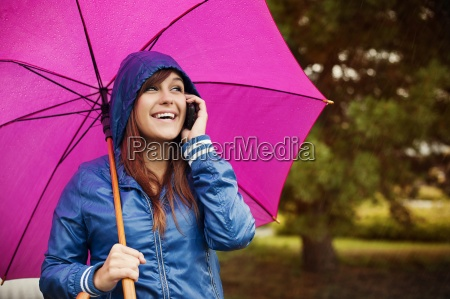 young woman with mobile phone on