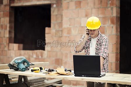 carpenter talking on mobile phone