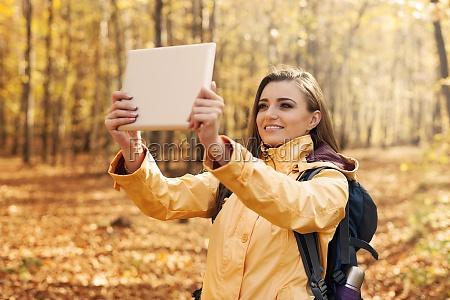 beautiful, woman, taking, photo, by, digital - 12110048