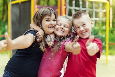 happy children showing ok sign on
