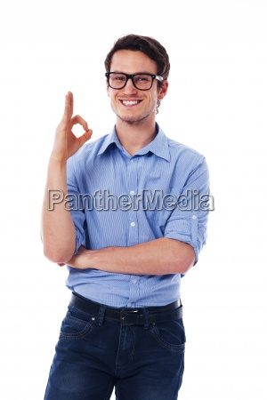 young happy man showing ok sign