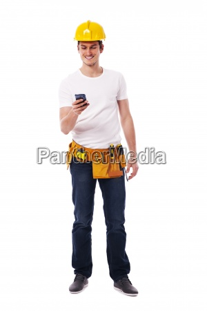happy construction worker with smart phone
