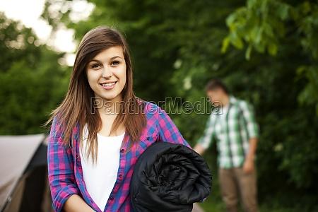 young woman with sleeping bag