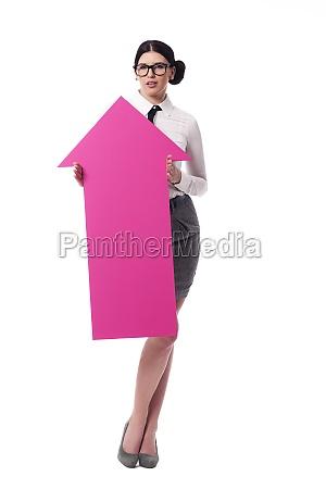 beautiful businesswoman holding pink arrow sign