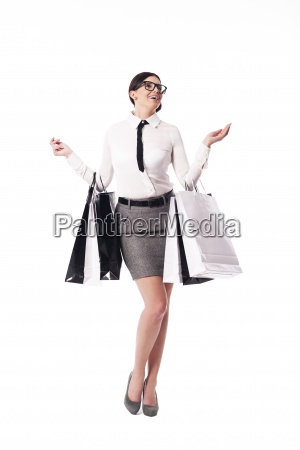 happy businesswoman holding full of shopping