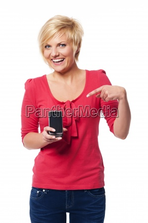smiling young woman pointing at screen